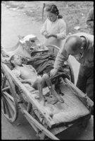 菊池俊吉「荷車で運ばれてきた少年」1945年10月11日 田子はるみ提供